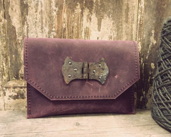 A beautiful handmade leather clutch to go out with.