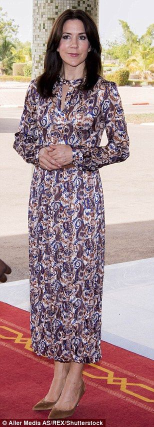 Casual chic: The mother-of-four opted for a printed maxi dress paired with brown…