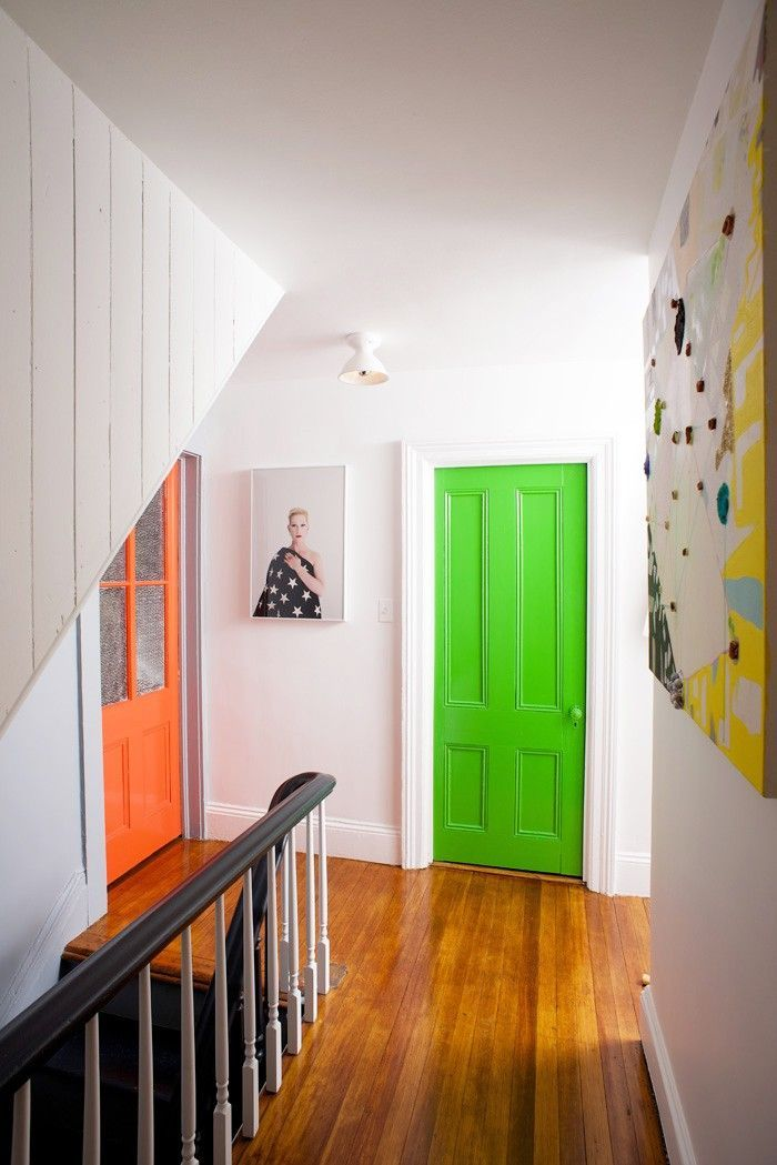 Eye-Catching Bold Doors -white hall with bold doors create a unique, playful atmosphere that feels fresh & cheeky!
