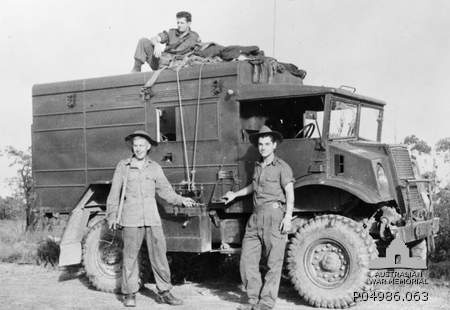 Three unidentified Australian soldiers with their Canadian Military Pattern Chevrolet C15A, 15cwt, wireless signals truck.