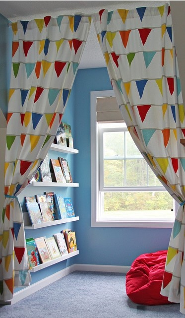 Kids Reading Nook: With book ledges & bean bags chairs. Curtains from Ikea hung on shower curtain rod. Doubles as a playhouse.
