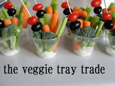 Individual veggie tray . . .started with plastic cocktail cups, standard Ranch dip- Squirt some into the bottom of each cup, add celery, broccoli, carrots, and skewer a tomato and giant olive.