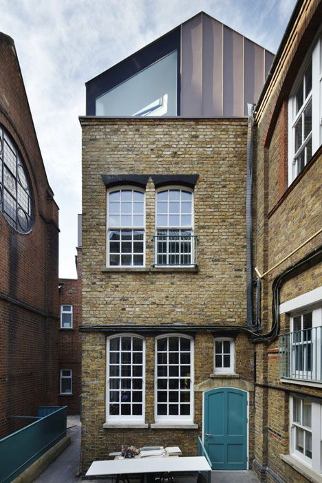 Modern addition to traditional building. Classroom extension by Studio Webb Architects