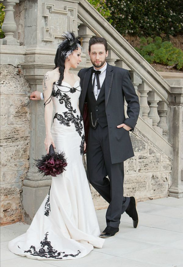 Incredible Victorian Gothic mermaid-style corset wedding gown. Such a pretty and unique dress!