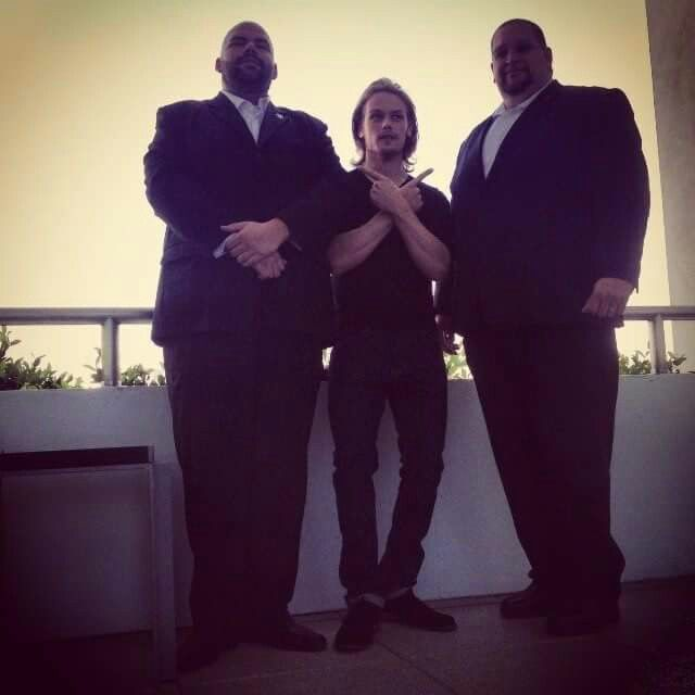 Sam Heughan & his monstrous bodyguards! They must be really tall to tower over him! LOL