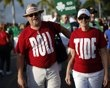 Alabama Crimson Tide fans wear Roll Tide shirts outside Sun Life stadium before the BCS National Championship college football game between Alabama and the Notre Dame Fighting Irish in Miami