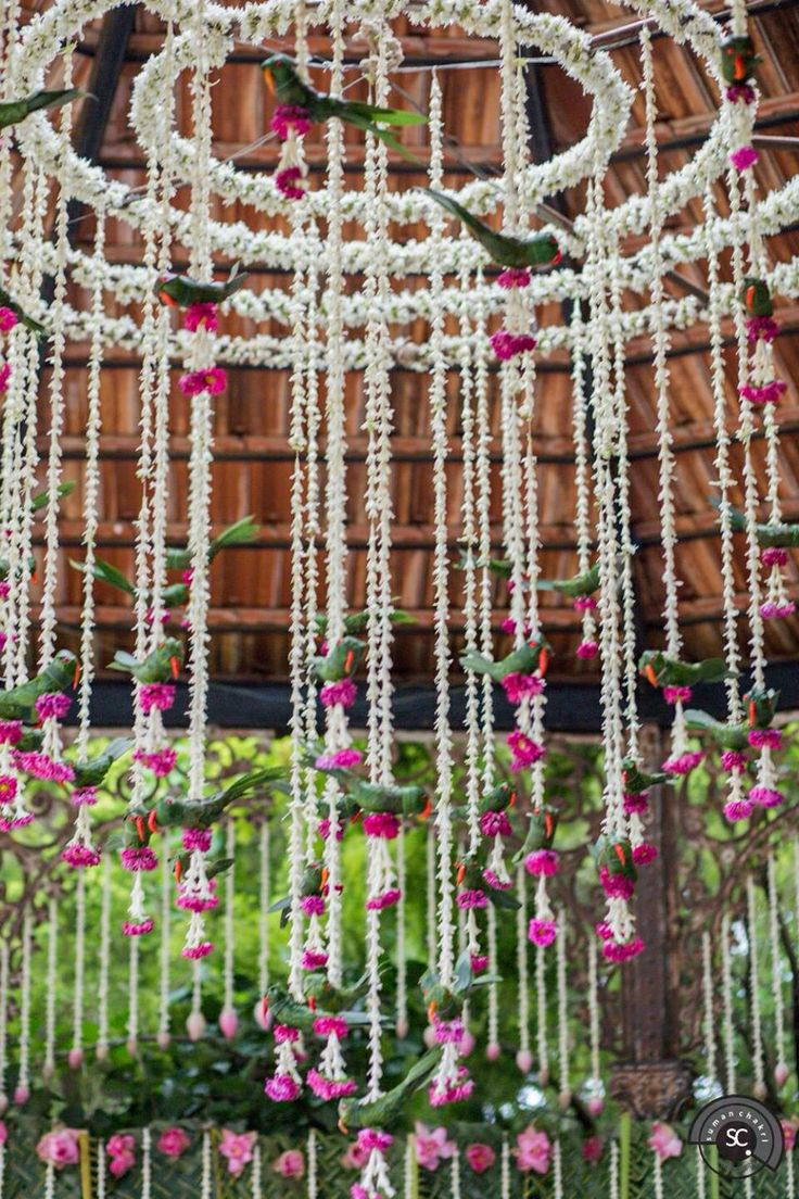 Use this beautiful white and purple flowers chandelier in your wedding decor and make the ambience prettier!