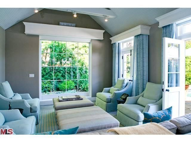 Grey And Blue Living Room With Cherry Wood Floors- Cannot
