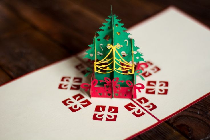 Christmas tree that appears from a simple peace of paper. 3D pop-up greeting card for Christmas that could melt hearts of anyone.