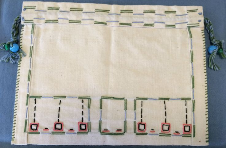 3. GM/10 - Embroidered bag by Grace Melvin. More information can be found on Grace Melvin on the GSA Archives and Collections Catalogue linked.