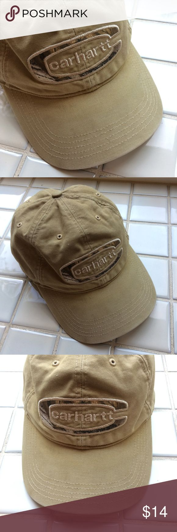 "CARHARTT Cedarville baseball cap — adjustable Size: one-size (adjustable hook-and-loop fastener) Color & pattern: khaki with contrasting forest print fabric inside logo and under brim Style: light-structured, medium-profile baseball cap with pre-curved visor and ""FastDry"" technology Material: 100% cotton washed canvas  Condition Gently pre-owned; no known flaws. Shipped with care from a clean, smoke-free environment.  Note: Color may vary slightly from photos.  PRICE IS FIRM. Carhartt…"