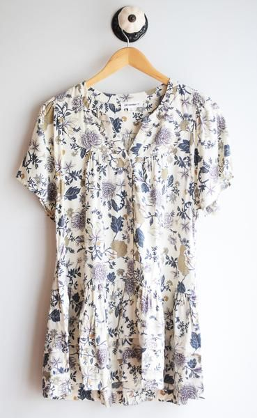 Floral loose button down tiered tunic with butterfly sleeves and has pockets! Nursing Friendly.  100% rayon handwash- line dry.
