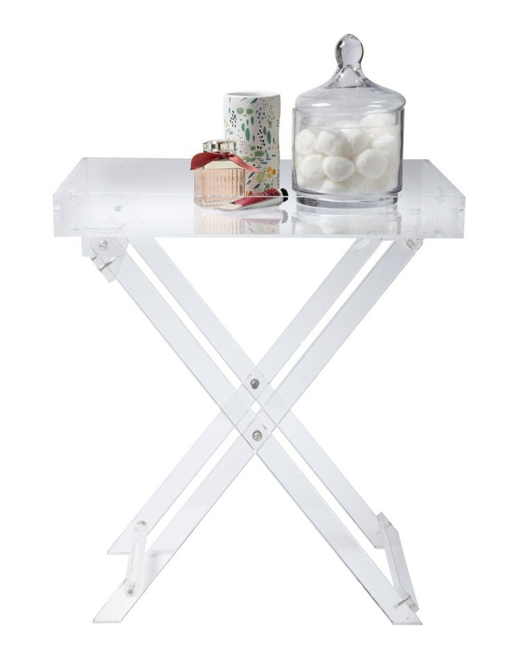 An acrylic card table will disappear in a small space. Handles table, $189; zarahome.com.