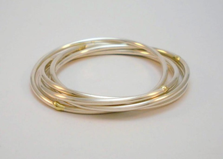 Five bracelets in one with golden knobs.