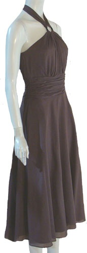 Simple and elegant, soft rich brown halter dress. Bodice has a ring with the straps that tie at the neck, pleating falls onto the bodice.  Side and back have boning.  Wide midriff is ruched and the skirt is full.  Dress is fully lined and closes with a back hidden zipper. Fabric content is 70% cotton, 30% silk.  Dress is new with original $158 price tag. Labeled White House Black Market.