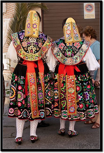 Traje de carbajal, de Zamora, Espana. Regional folk dress of Zamora in western Spain. The bead work is one of a kind, applied by hand, and often these items represented a family's best women's clothing, worn as wedding apparel. by grebarsan, via Flickr