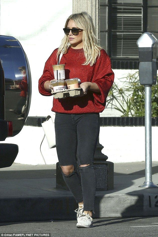 Hilary Duff is spotted on a coffee run in LA, wearing ripped jeans #dailymail
