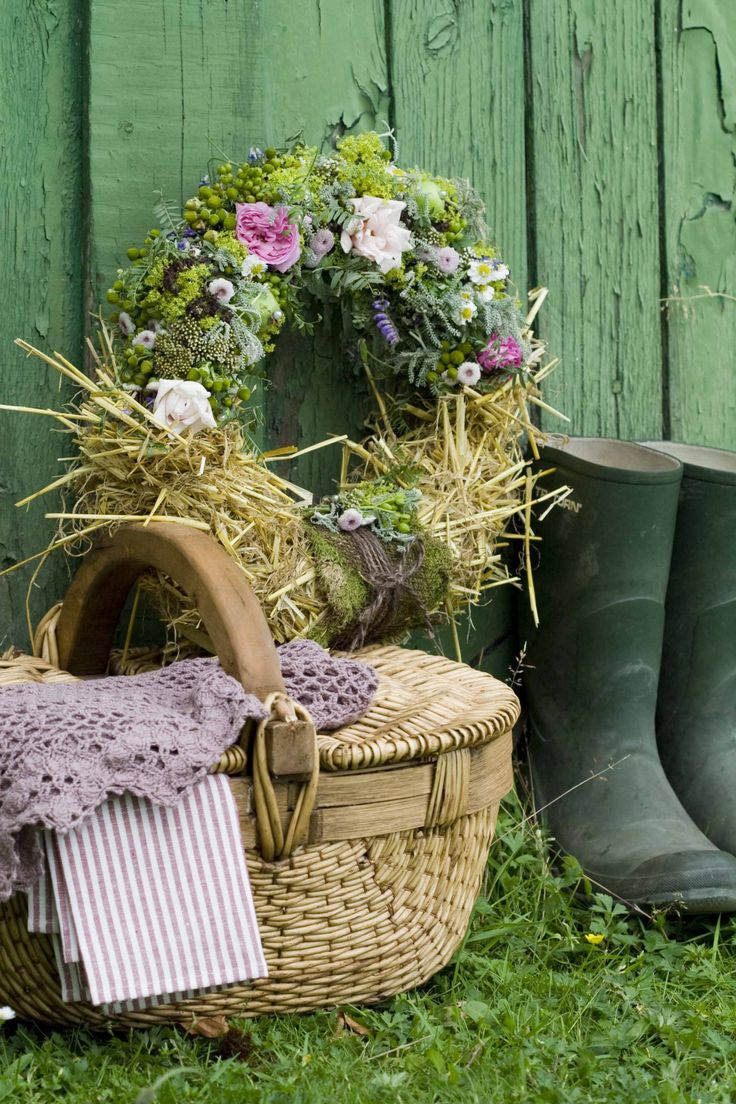 Gorgeous Basket from a very skilled craftsman, floral wreath and green wellies.