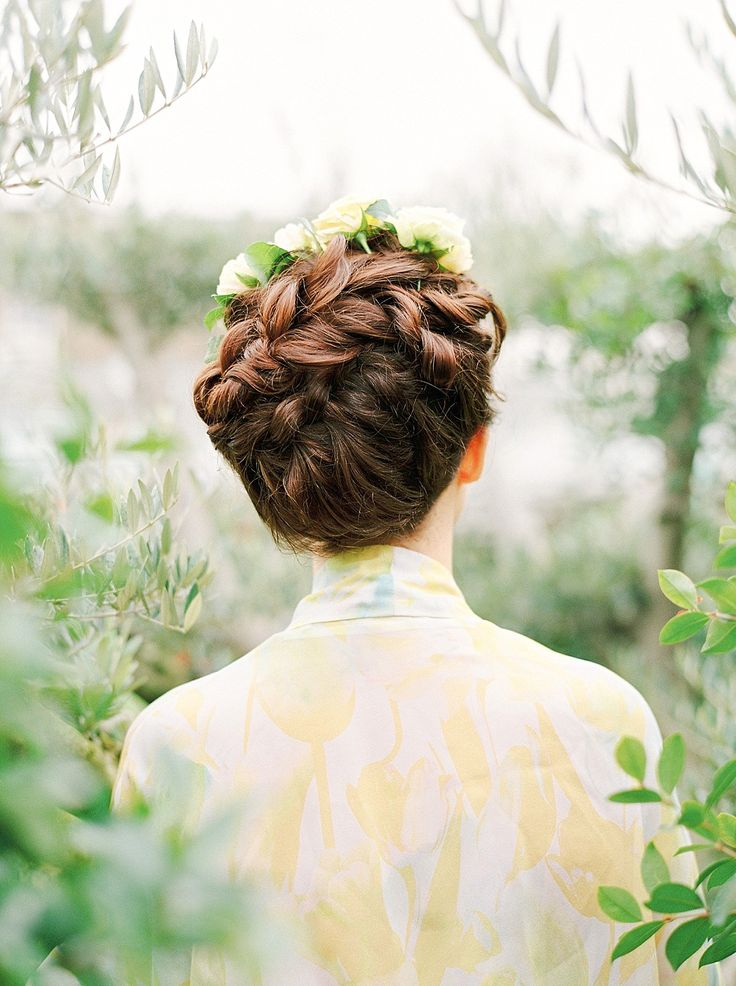 Braided bridal up do inspiration from a leafy green, gold and 'elegant luxe' inspiration for brides. Shoot styling + concept by The Wedding Bazaar, film photography by Georgina Harrison.
