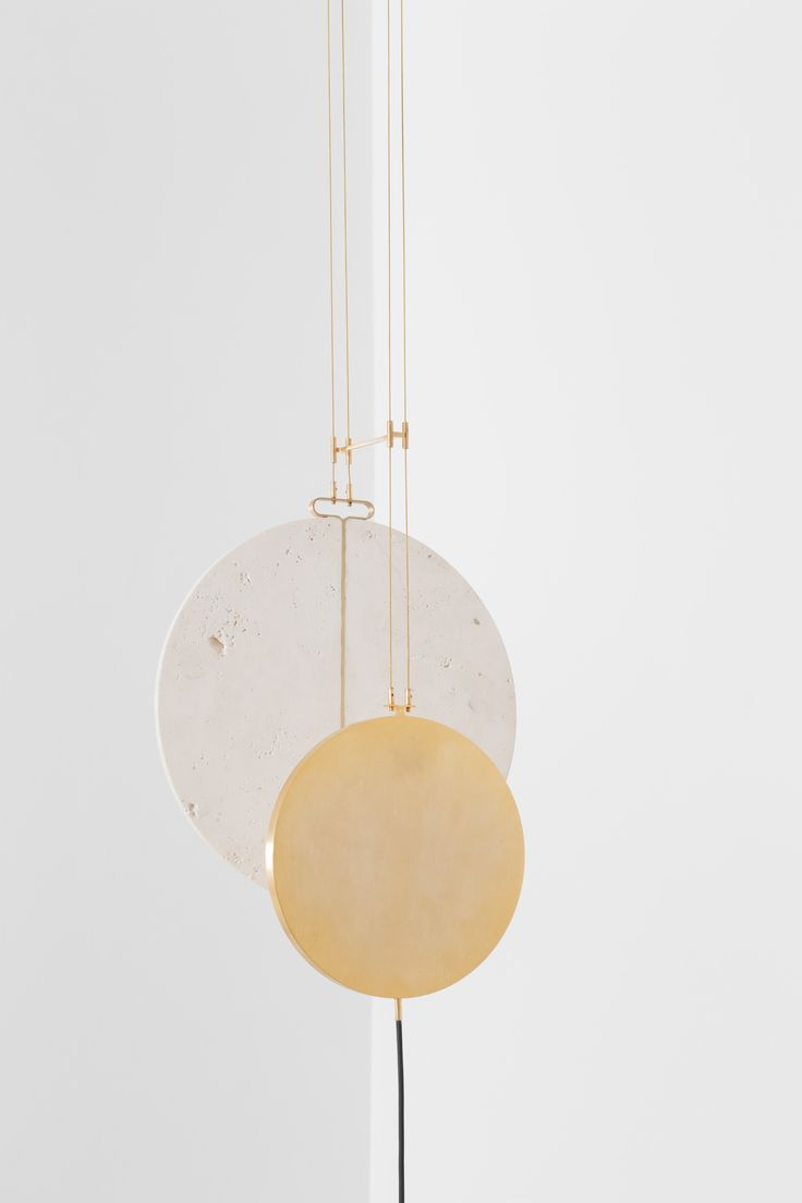 Delta Collection, Eclipse by Studio Formafantasma |   Eclipse, ceiling lamp (2016). Materials include; polished gilded brass, travertine, perspex, gilded guitar strings & LED.   Source: http://www.yellowtrace.com.au/studio-formafantasma-delta-collection/