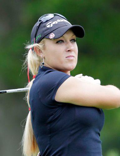 Natalie Gulbis   http://www.menshealth.com/guy-wisdom/hottest-women-of-golf/slide/14