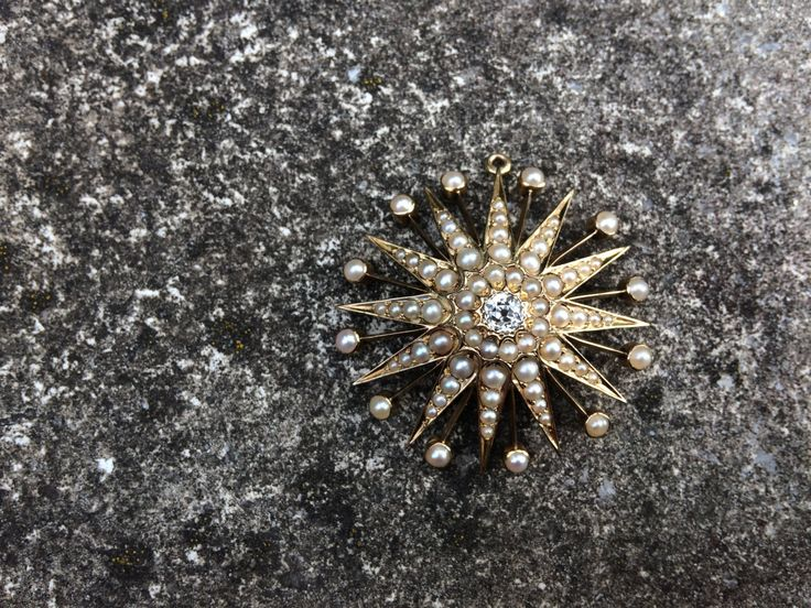 Victorian 12 ray star pendant with 0.4 ct old-cut diamond and split pearls. by ArtJewelsStore on Etsy