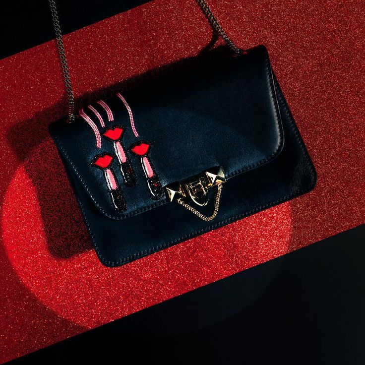 Choose a classic Demilune black leather bag with LipstickWave embroideries by Zandra Rhodes for the perfect gift. Discover more holiday gift ideas on Valentino.com