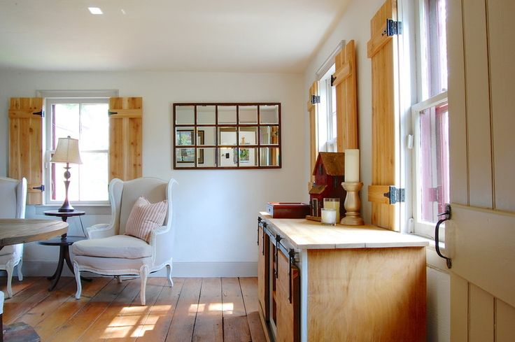 natural wood board and batten interior shutters