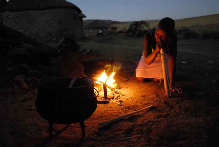 """IRIN - """"Lineo Makojoa, 15, cooks dinner at her home in Ha Majoro Village in Lesotho. Orphaned by HIV and Aids, she often cooks dinner for her grandparents and her older brother.  © Eva-Lotta Jansson/IRIN"""""""
