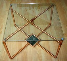 Glass table with copper pipes