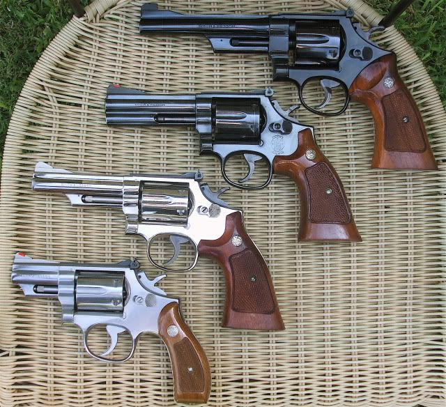 Four different Smith & Wesson .357 Models Second one from bottom- my first home security system.