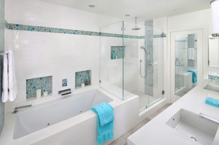 white shower with blue and green accent tiles