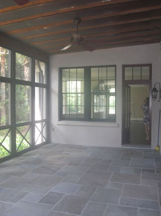 Screen porch - X railing design and slate floor   If you need your pool cage or lanai screens fixed or just want a FREE quote, call us at (813) 928-8118.  We serve all of the Tampa Bay area.