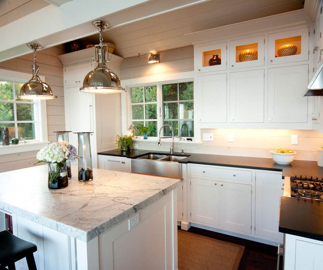 kitchen cabinets with honed black granite countertops, white kitchen