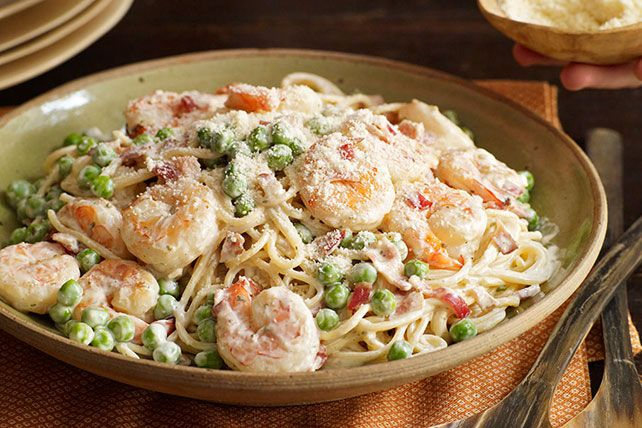 The best Italian place in town? Your kitchen. In 25 minutes you've got a pasta classic that combines savory bacon with tasty shrimp and peas in a creamy sauce. Buon appetito!