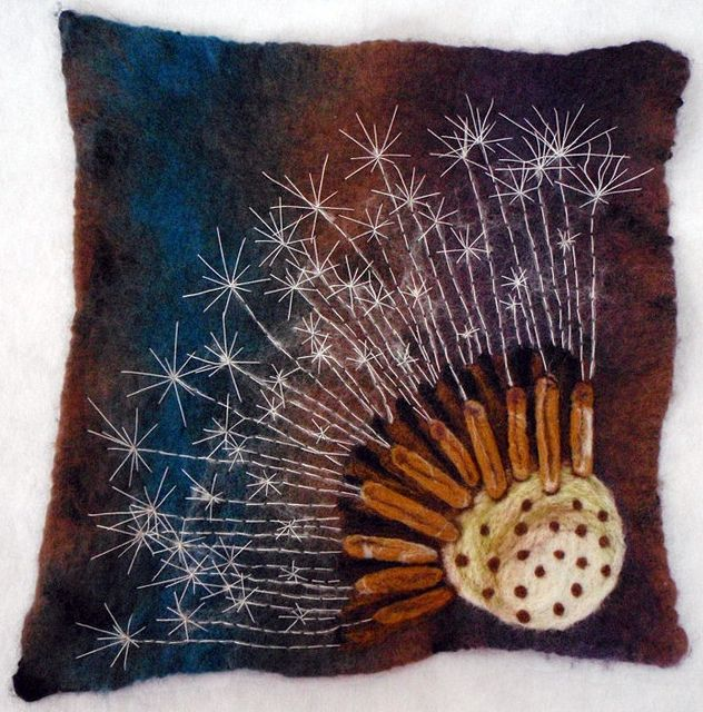 Dandelion.  An embellished piece of felt. Hand dyed wet felted background, Needle felted seed head and hand sewn seed wings.  By Maria Dent, Creative Bumble Bee