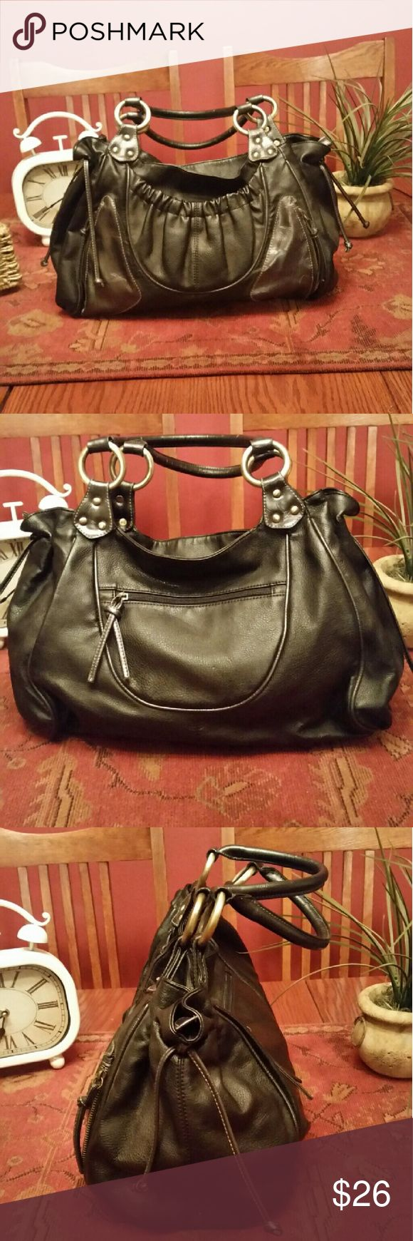 David Jones Paris X Large  LeatheShoulder Handbag Xlarge, black,very good condition with the exception of interior zip compartment side seam rip,can be mended with material seam tape, it has 2 slip pockets, 1 zipper pocket, exterior has a side zipper pocket on each side of bag, 1 zipper compartment in back of bag and a open pocket in front that has a snap closure, for a preowned bag it's in very good condition and x large, pics don't do it justice  much prettier in person David Jones Paris…
