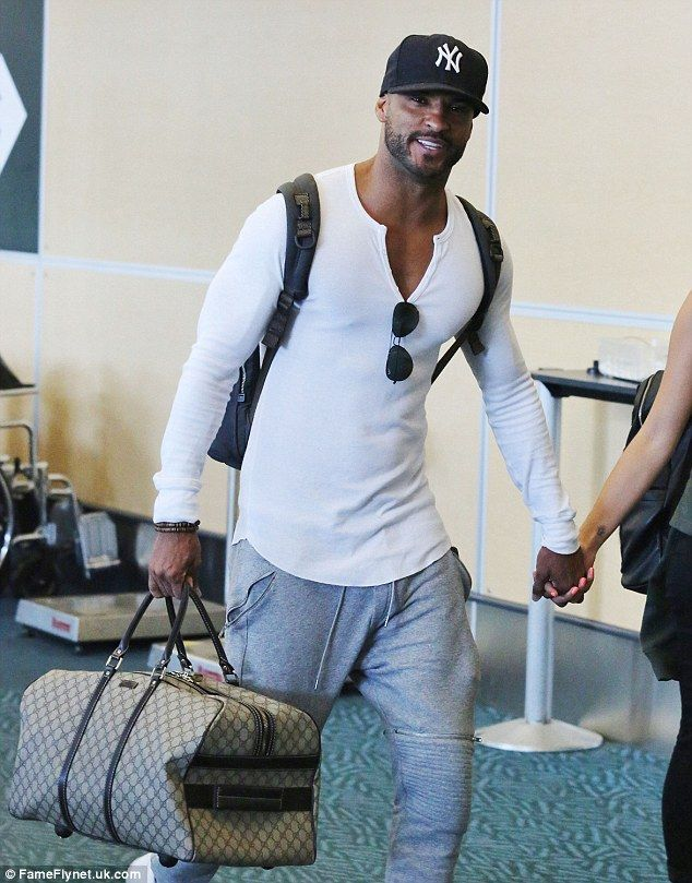 Happy: Ricky could not wipe the smile off his face as he and his new squeeze caught a flig...