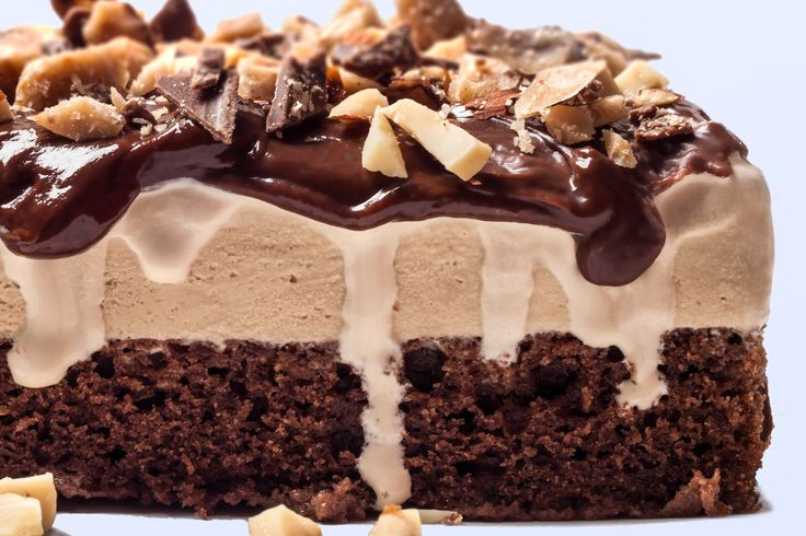 A rich ice cream cake recipe, with layers of chocolate cake and coffee ice cream, under chocolate ganache, toffee bits, and chopped almonds.