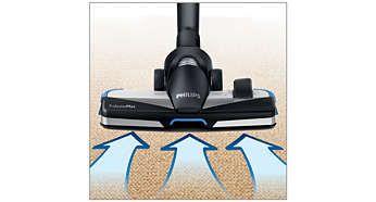 Capul de aspirare TriActiveMax cu acţiuni de curăţare 3 în 1 acoperă perfect podeaua pentru a maximiza colectarea prafului. 1) Deschide uşor covorul cu talpa specială, pentru a îndepărta praful până în profunzime. 2) Aspiră elemente mari cu orificiul mare din partea frontală. 3) Şterge praful şi murdăria de pe mobilă şi de pe pereţi cu cele două perii laterale.