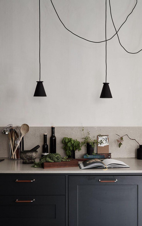 Dark kitchen with a beige countertop