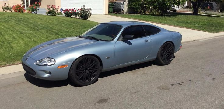 Car brand auctioned:Jaguar XK8 Black 1997 Car model jaguar xk 8