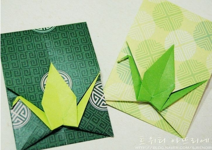 origami envelopes with a cranes folded in ...