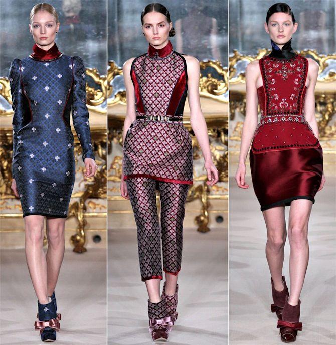 Aquilano un traje más sencillo con tejidos brillantes y estampados geométricos o con toques medievales. Alzacuellos y zapatos con los mismos tejidos completan el look.