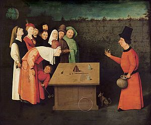 """Hieronymus Bosch """"The Conjurer"""" - fooled by lack of alertness & insight, The central character & true focus is the man of rank who leans in, fixed on the pearl while unaware of being relieved of his purse. Bosch associates the conjurer as a common criminal luring in prey.Animals symbolize human traits that allow for deception& victimization. The owl signifies his intelligence.Frogs jumping out of the mouth represent the extent to which the victim let go of reason, gave in to animalistic…"""