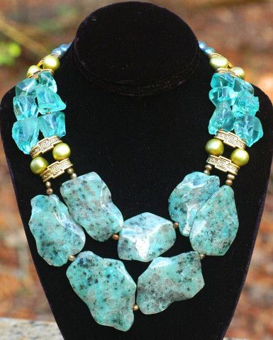 Marbella What a fantastic piece of art to wear jewelry for making a statement this summer! A gorgeous and classic color scheme and architectural gallery styling