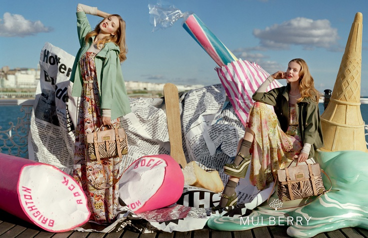 Mulberry's Spring Summer 2012 season visits the Great British Seaside by way of the UK's Brighton Beach, inspired by creative director Emma Hill's memories of the English seasides of her childhood. An original pier against the backdrop of bright blue sky became the canvas for our seasonal campaign shoot, framed with dramatically oversized props and the bold brights of the new collection.