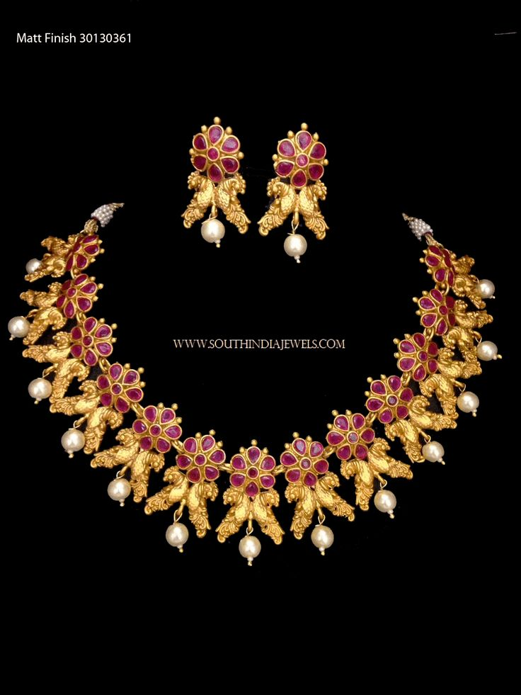 Gold plated short ruby choker necklace set. For more ruby necklace designs, check out the complete collections on our website.