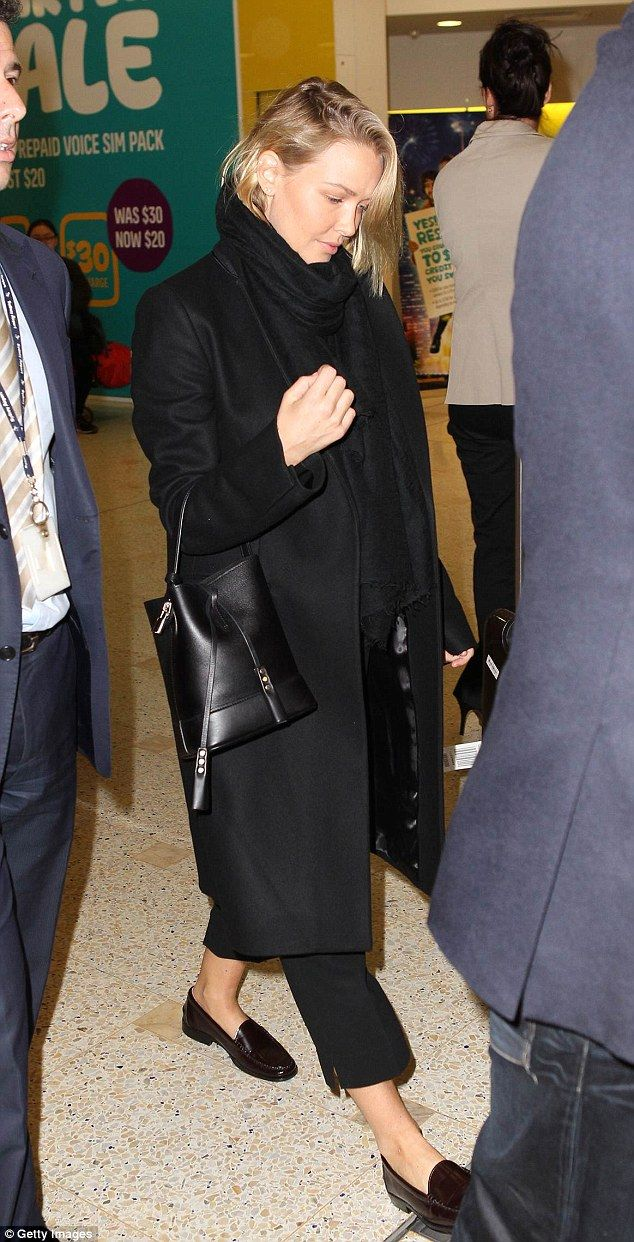 Lara Bingle (with a Louis Vuitton bag) arrived at Sydney Airport.  (October 2014)