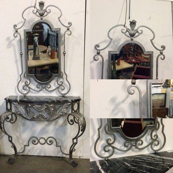 console louis XV en fer forgé avec sa glace ,patinée argent,dessus marbre veinée